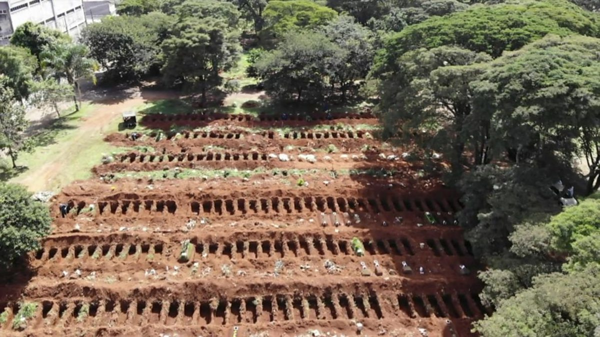 This photo shows one of the many Corona-virus mass grave in Brazil. There have been so many deaths that they are digging graves everywhere, I believe that they have even buried their deaths on the beach.