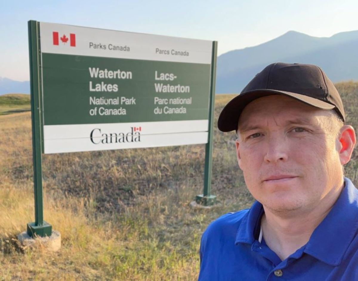 This is the Waterton Lakes National Park entry sign along the highway. Canadian national parks commonly have a sign like this as you enter.