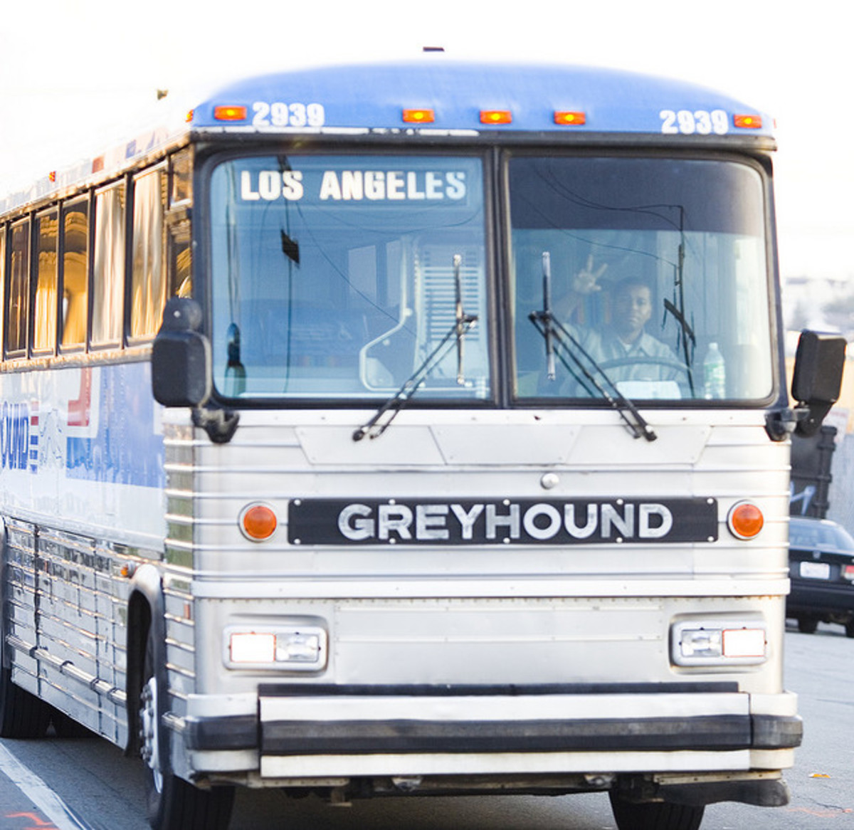 Greyhound Buses are a familiar sight. Here the driver gives a friendly wave.