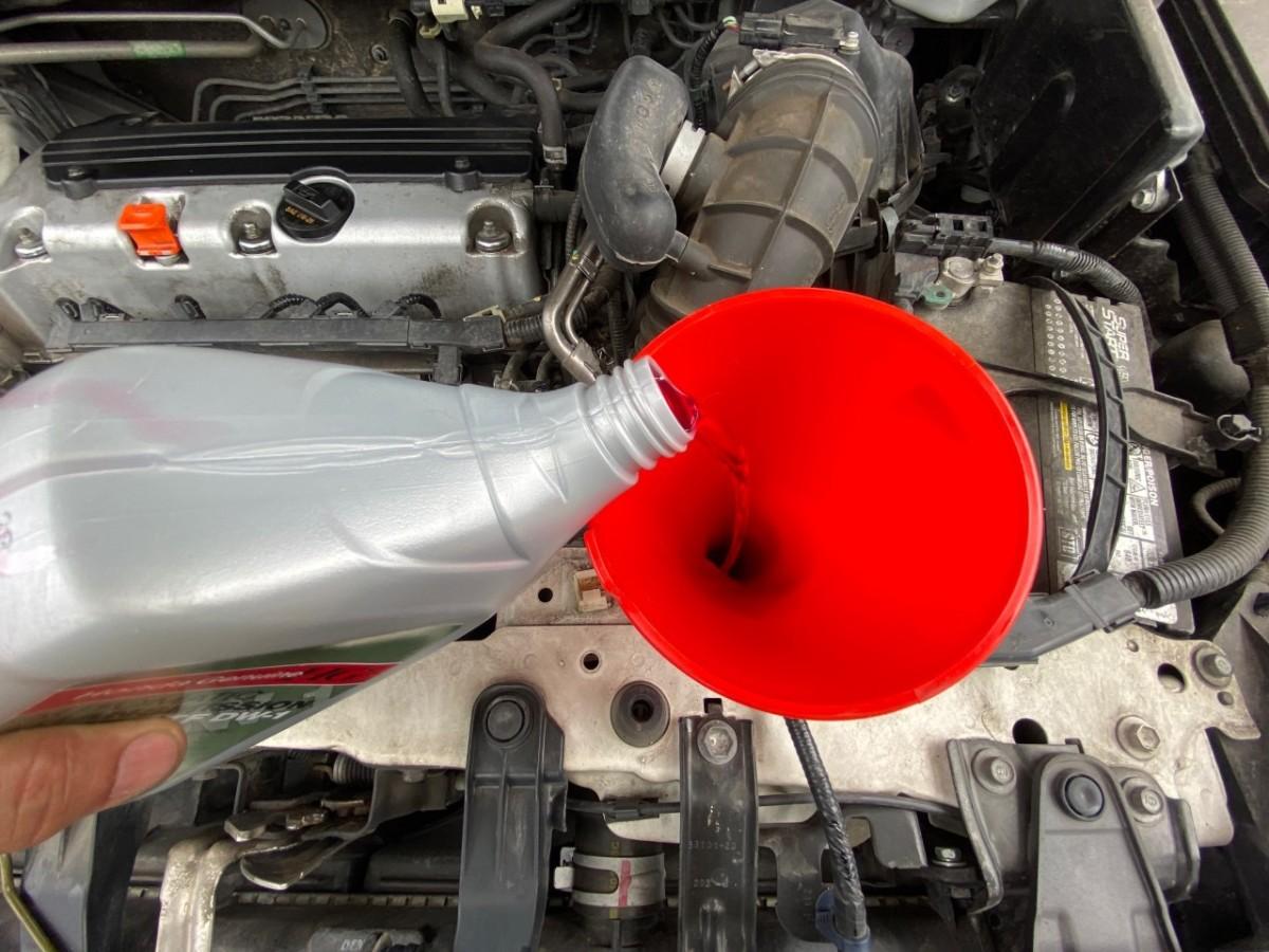 Adding new transmission fluid