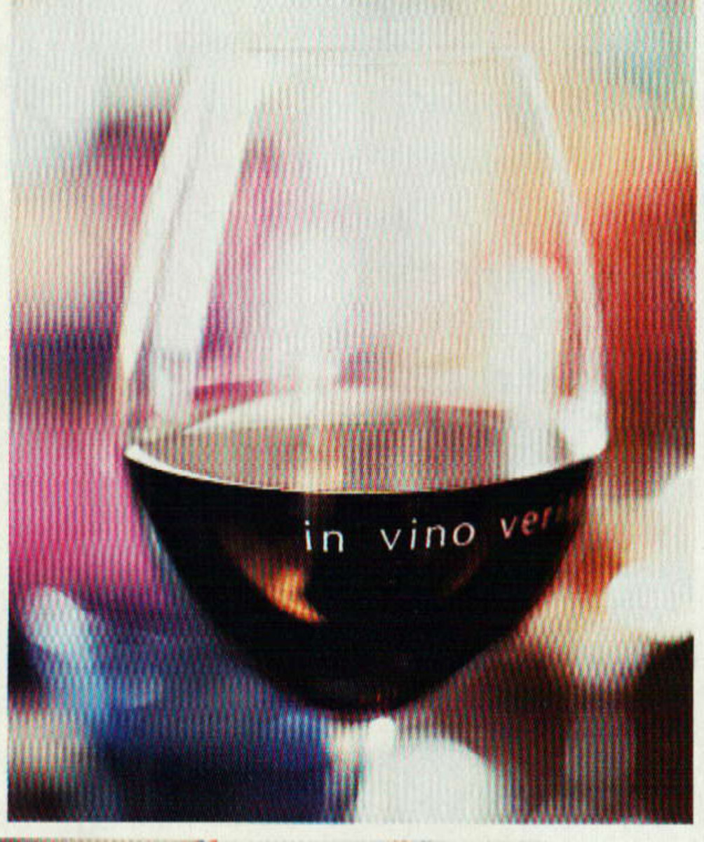 """Using dry transfer sheets, write something witty onto the glasses. In vino veritas; meaning """"in wine [there is the] truth""""  or wine proverbs. The rubbed letters wash off easily with a little soap and water."""