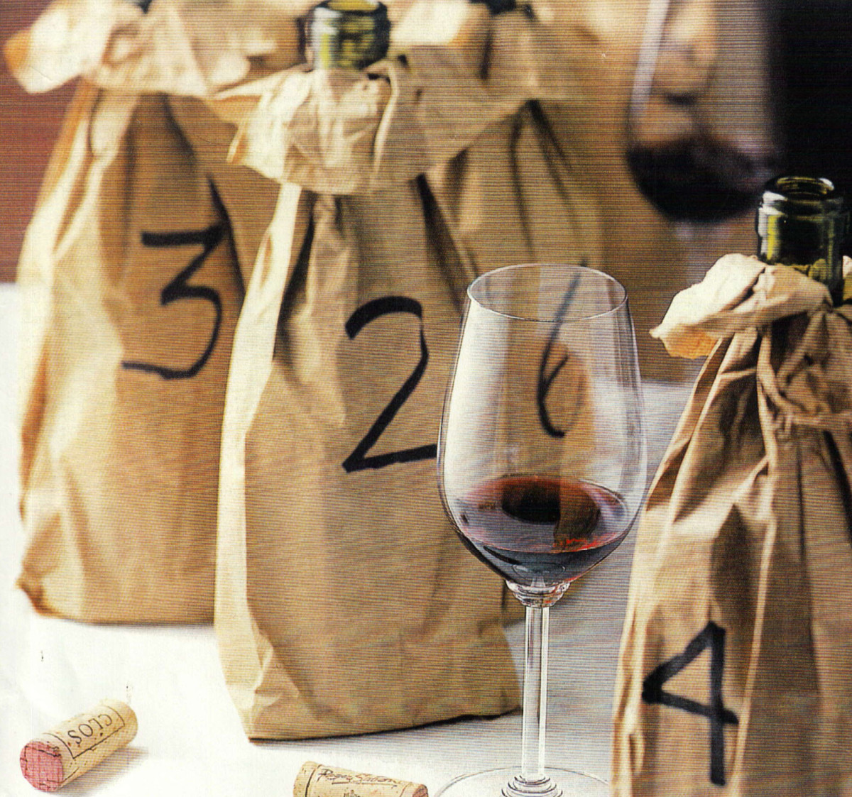 Disguising your wine bottles need not be fancy. If your opting for a blind tasting, this is a simple and creative wine to mask the vessels.