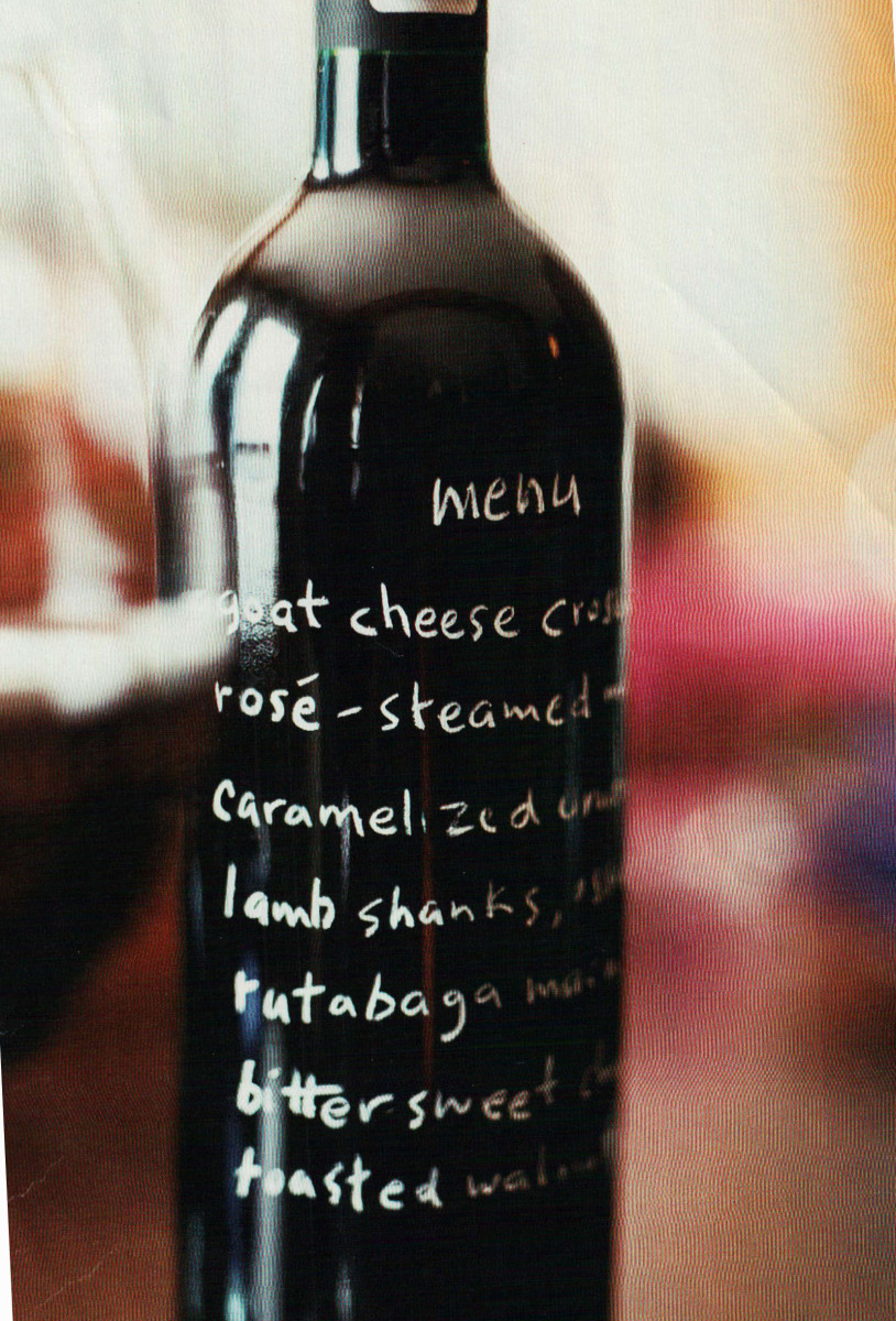 Using an empty bottle as a menu card is fun and easy. Use a white glass marker to let your guests know what you'll be serving.