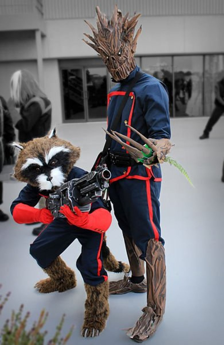 A cosplay picture of Rocket Raccoon with Groot Dragon.
