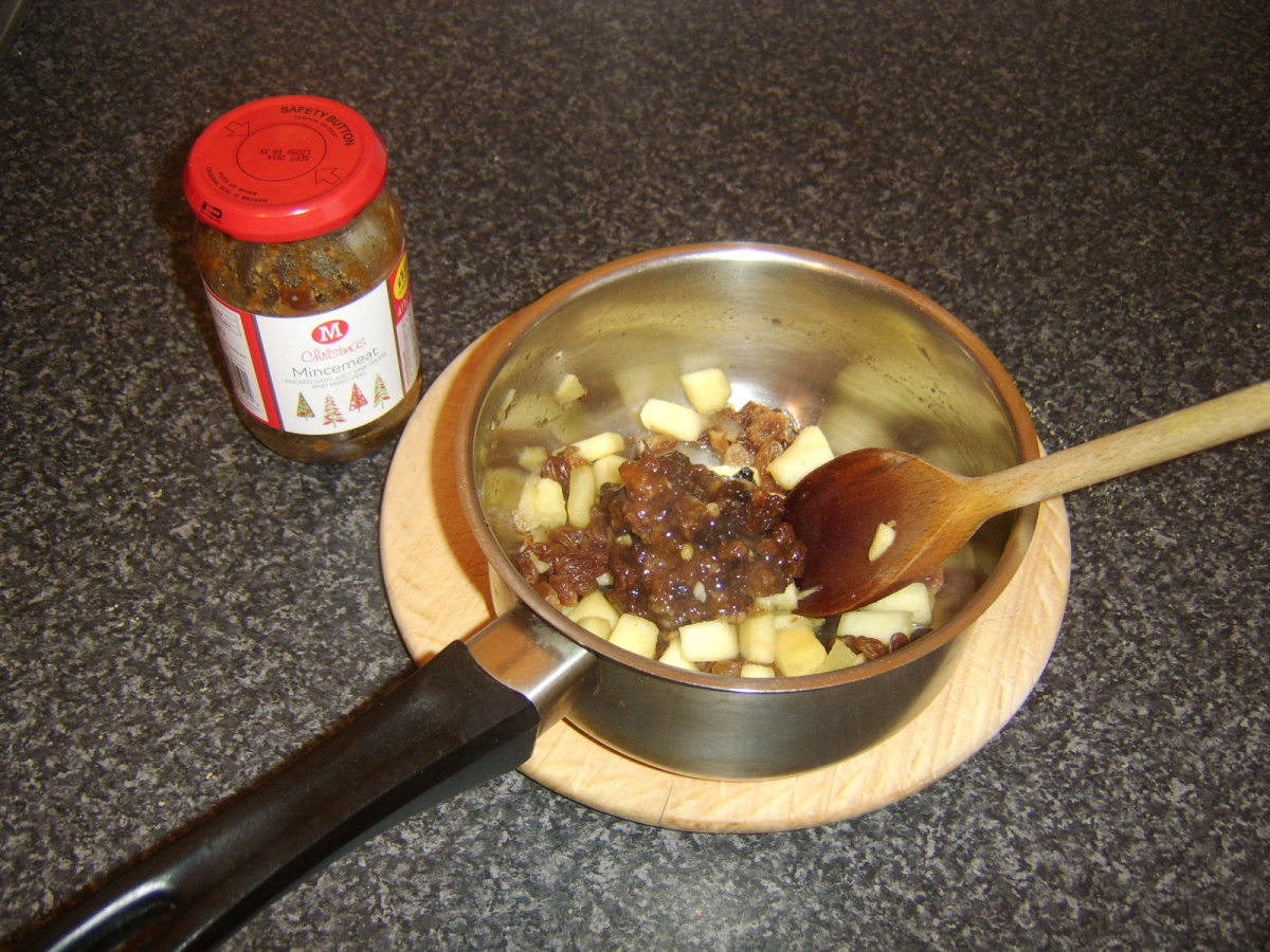 Mincemeat is added to stewed apples and sultanas