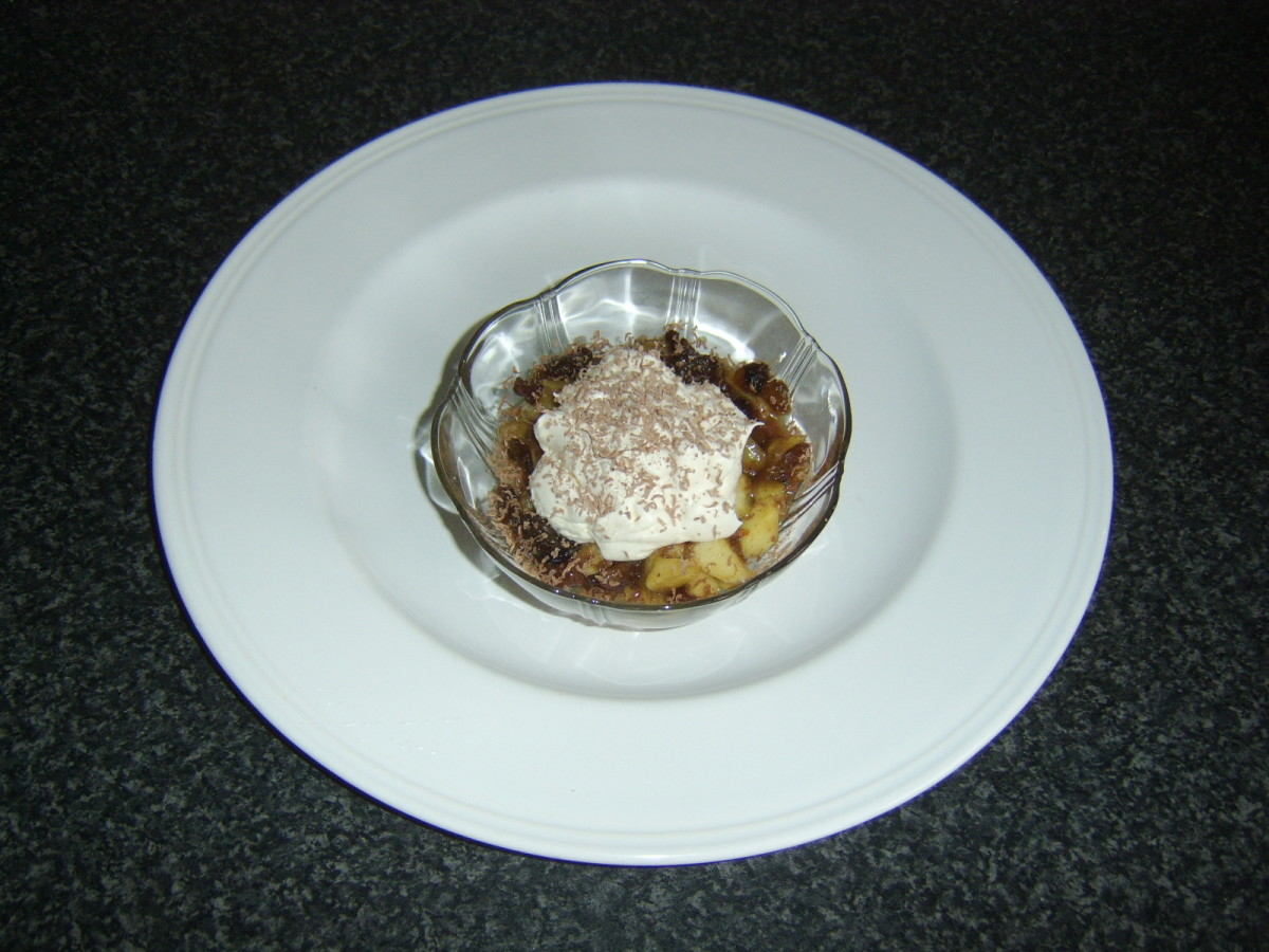 Simply stewed apples and sultanas mixed with mincemeat and topped with whipped cream