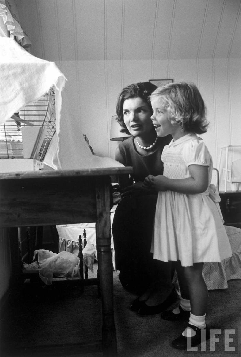 Jackie Kennedy and daughter Caroline by Alfred Eisenstaedt photo watching bird in cage at home