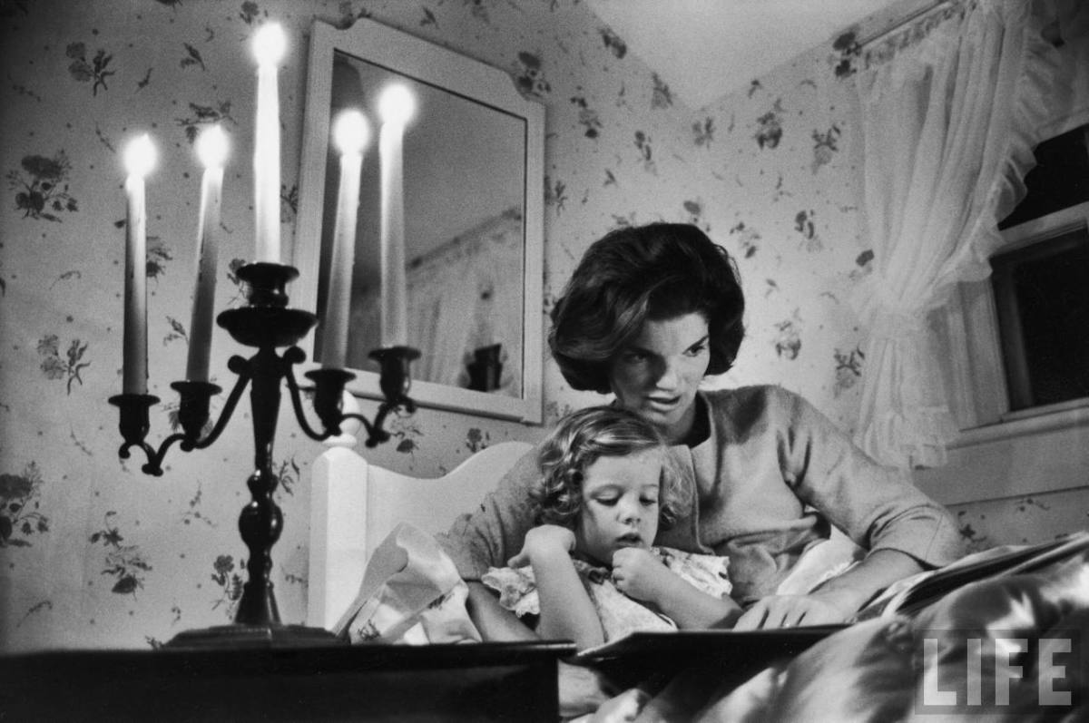 Photo of Jackie Kennedy with Caroline in her lap