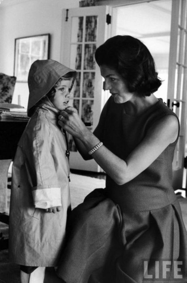 Jackie Kennedy helping a child