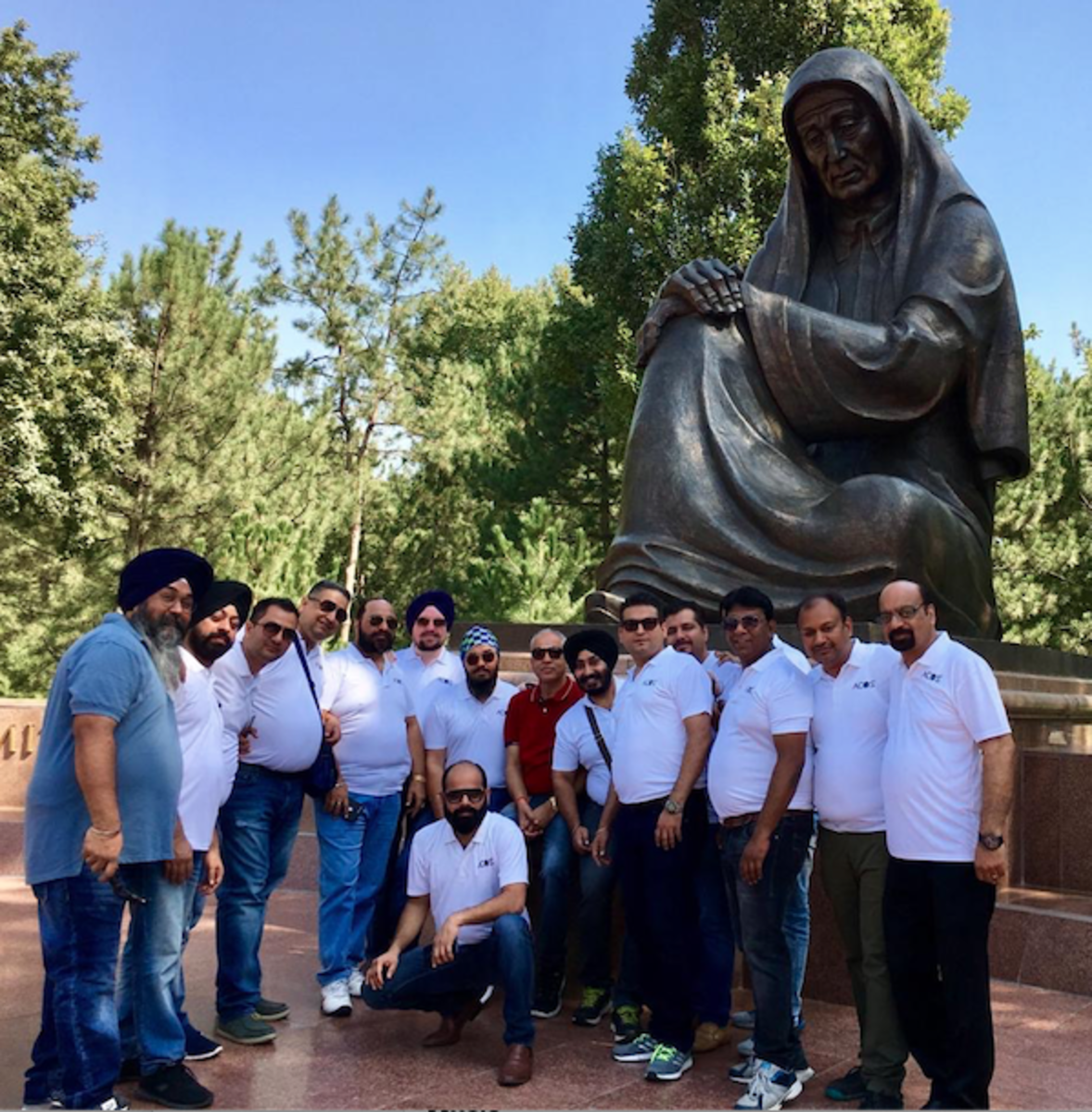 group photo in front of Statue of Mourning Mother