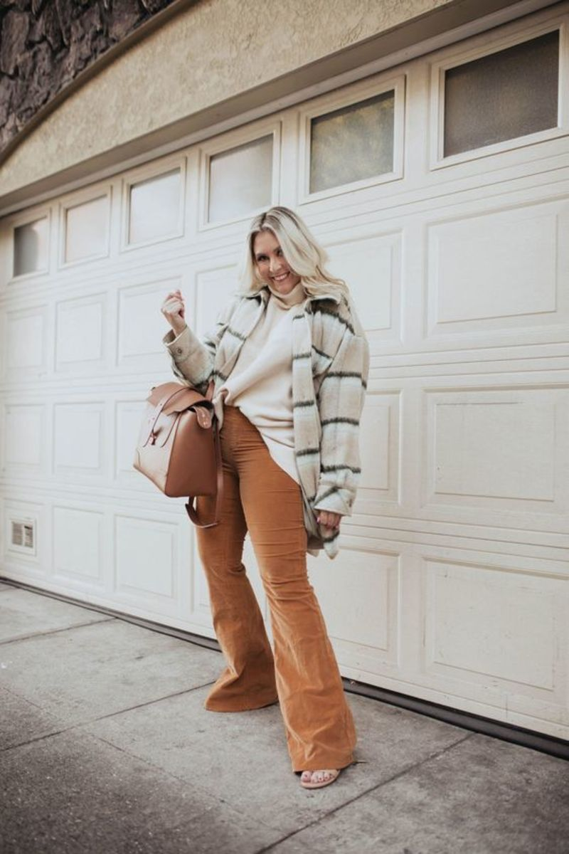 Flare pants look amazing paired with a shacket.