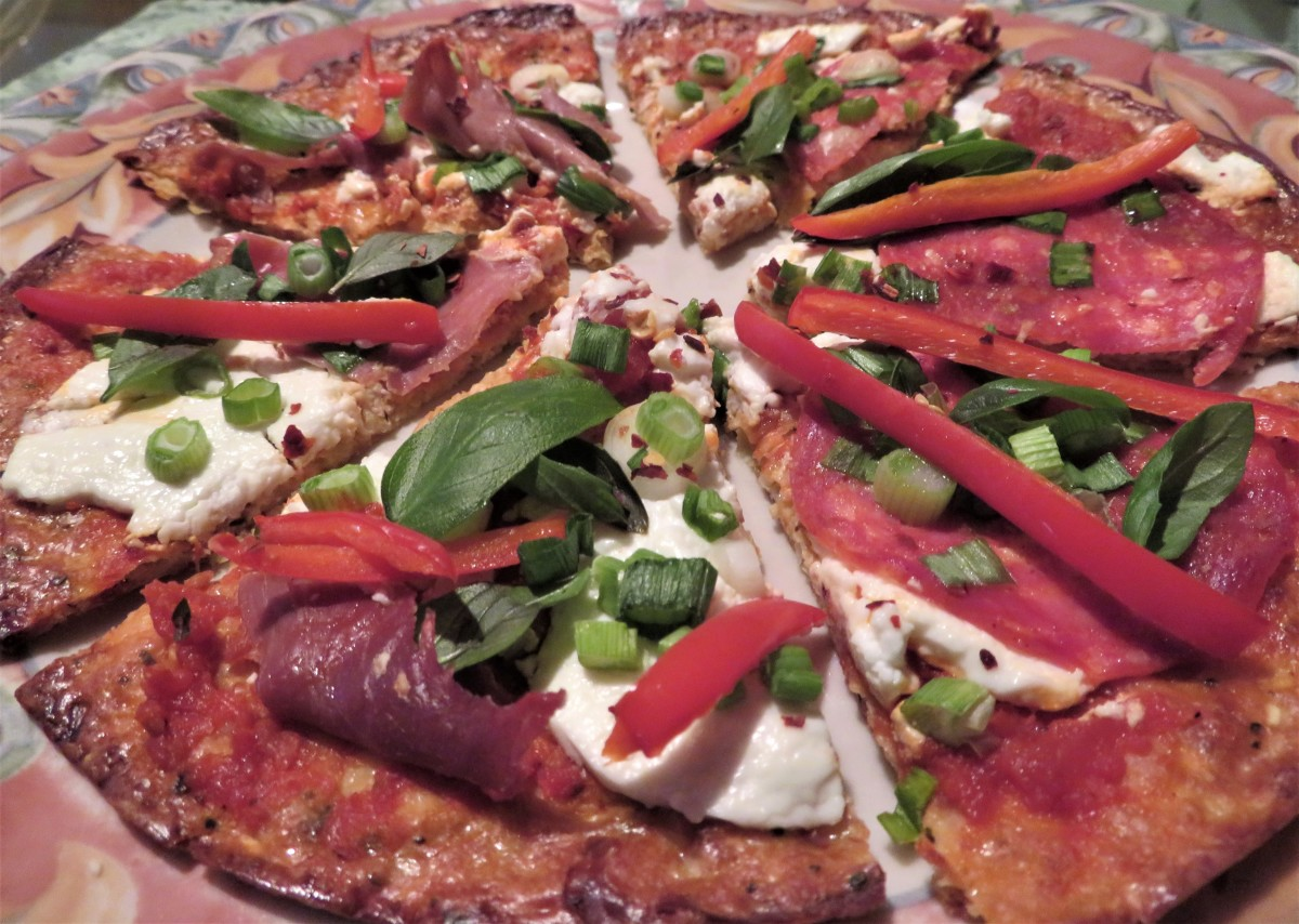 Pizza with goat cheese, red pepper, and Italian meat