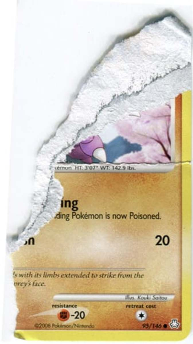 A legitimate Pokémon card with a thin black ink layer, separating two distinct layers of material that make up the front and back of the card.