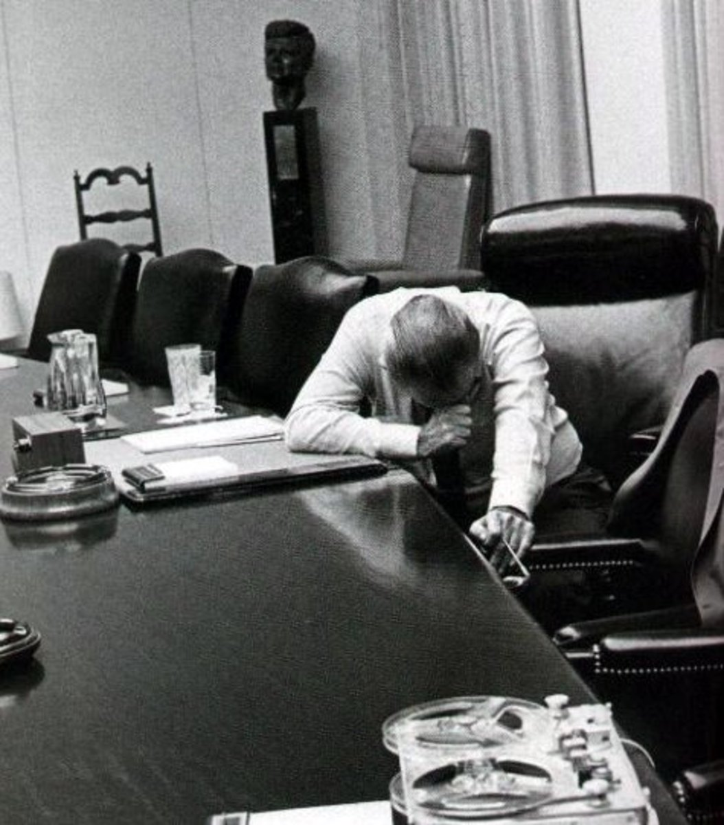 President Johnson listens to a tape in which his marine son-in-law describes his experiences in Vietnam.