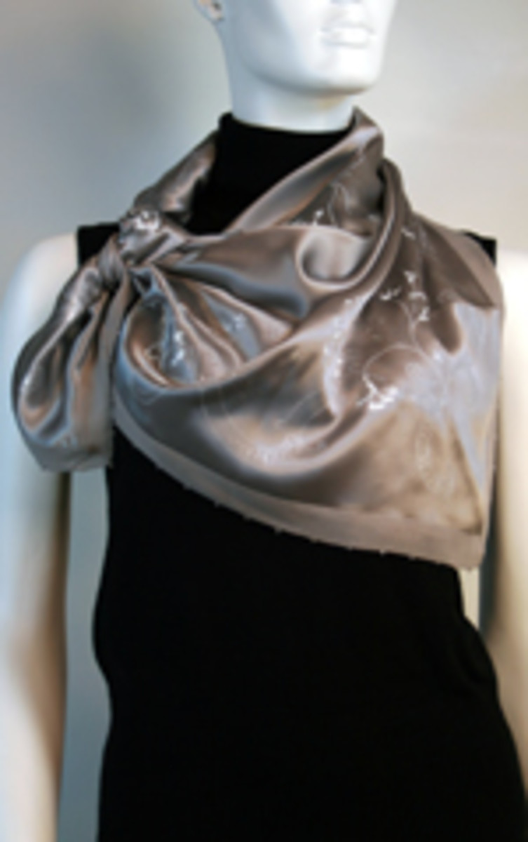 The elegant look with a bow at the side www.fashionscarvesandshawls.com