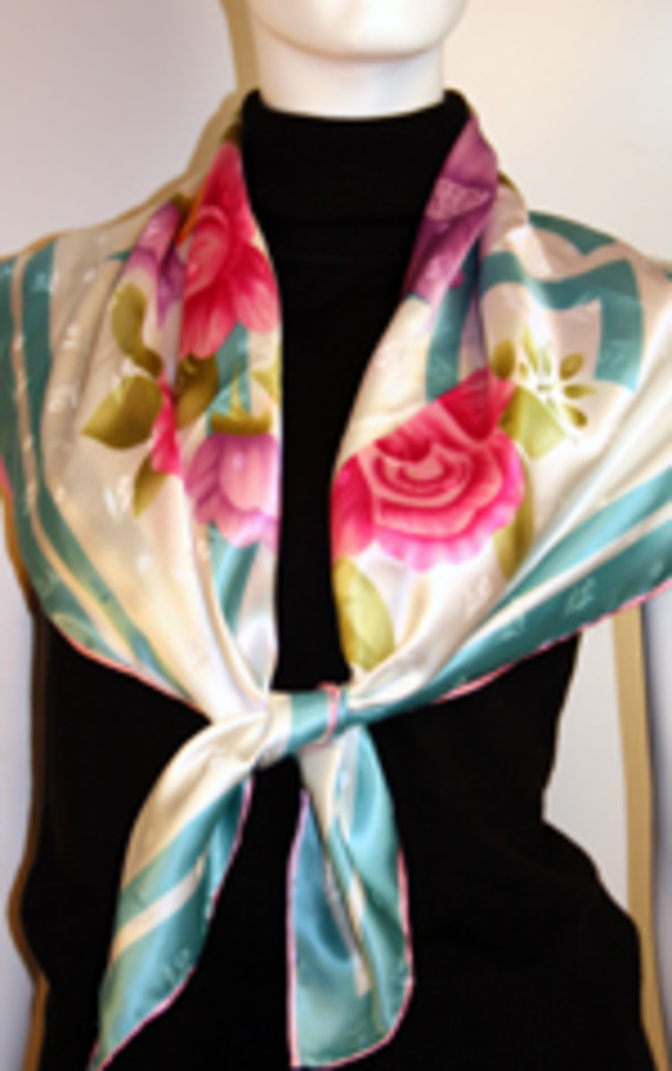 The elegant look with the knot in front www.fashionscarvesandshawls.com
