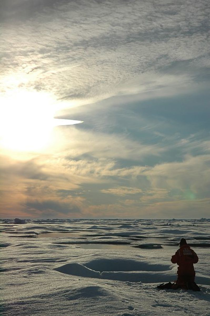 Arctic scientist in the sun.  Image by Jerry Potter, courtesy NOAA & Wikimedia Commons.