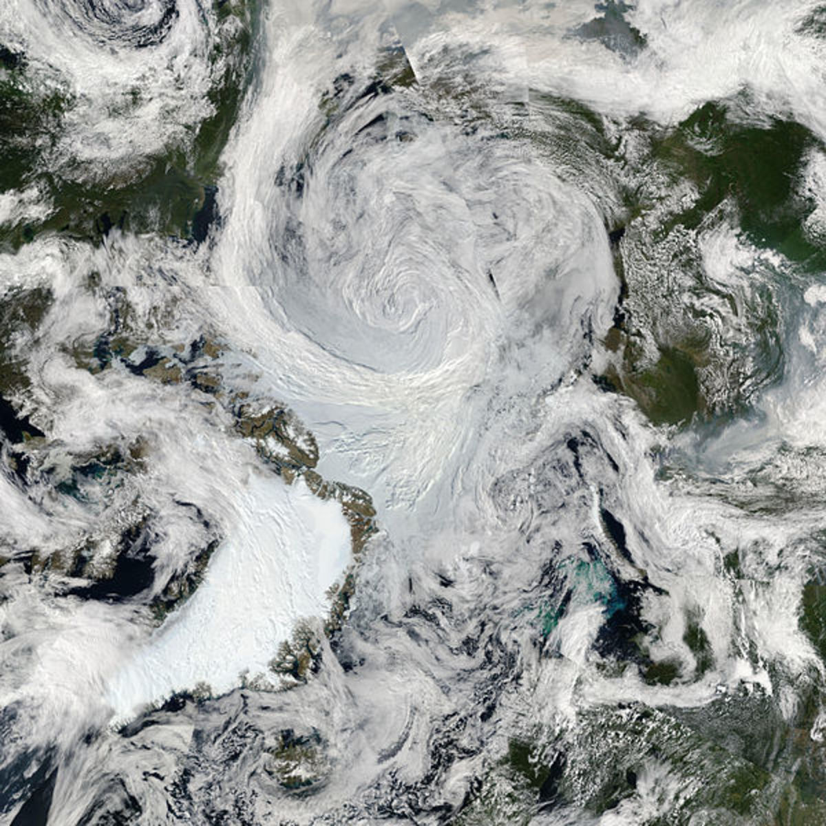 Arctic summer cyclone from orbit, August 6, 2012; Greenland is lower left.  Image courtesy NASA & Wikimedia Commons.