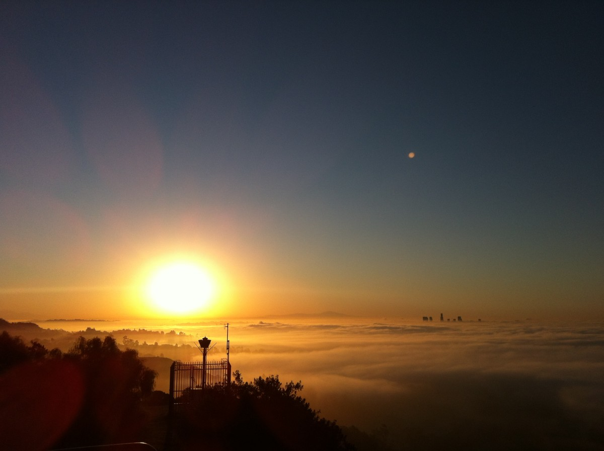 Sunrise from the Mulholland Drive lookout point in Hollywood / Los Angeles, California