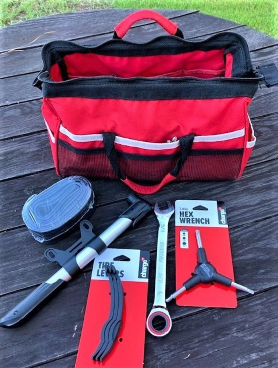 Simple tool kit with a spare tube, portable tire pump, tire lever, and wrenches.