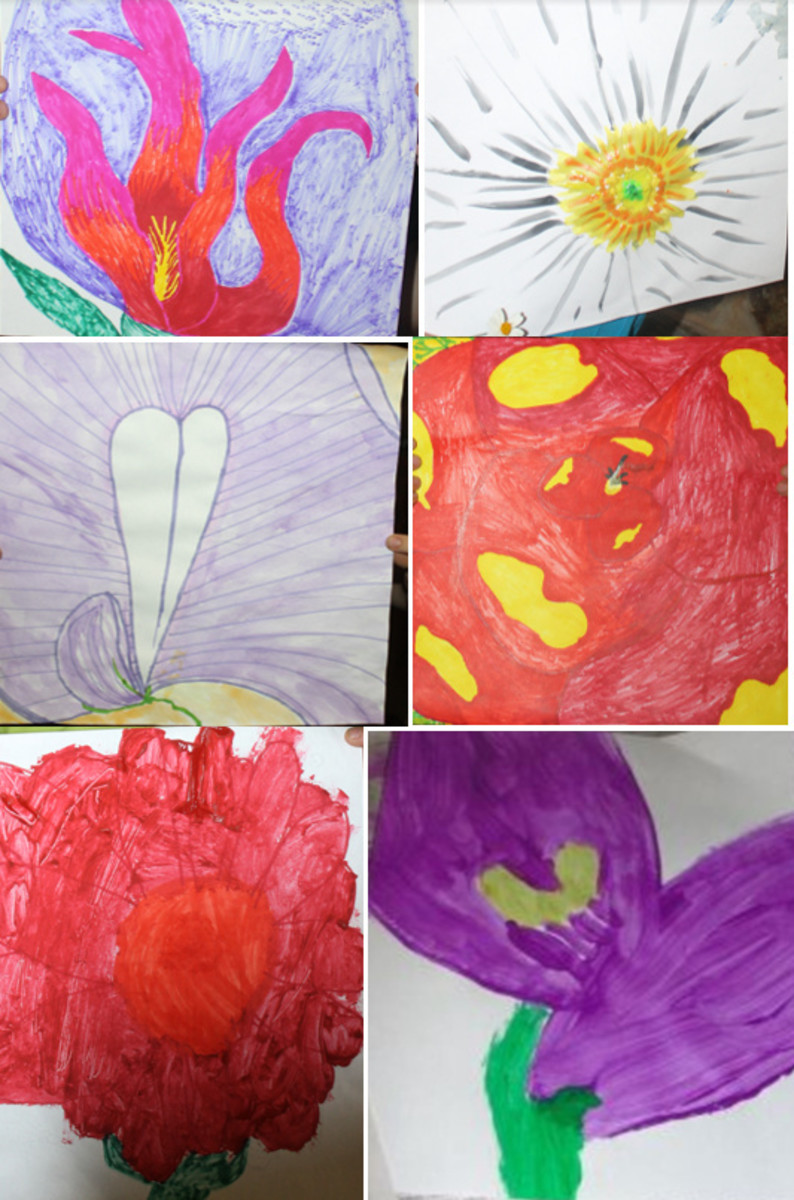 Some of the Georgia O'Keeffe inspired flower paintings from this activity