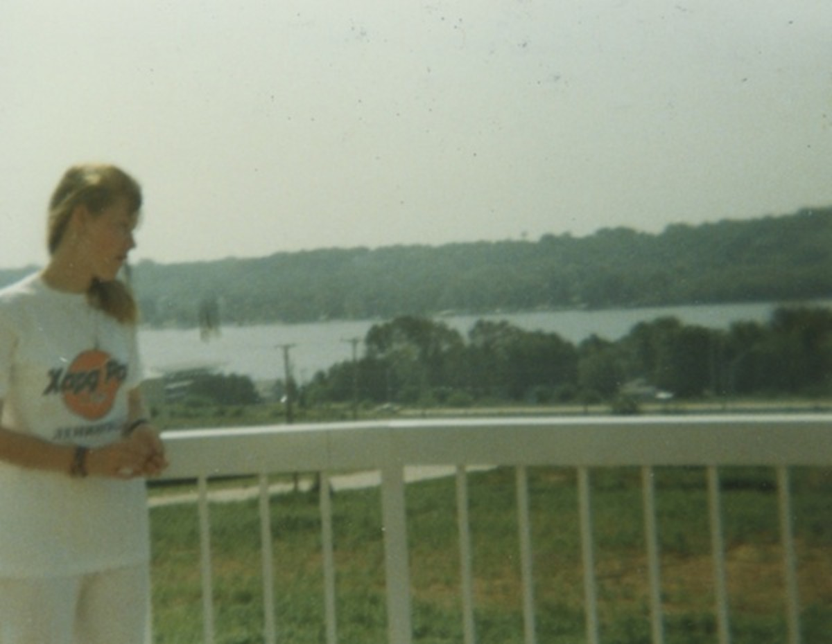 "My daughter is looking out at the ""Old Man River"" from the balcony of the Welcome Center at Le Claire, Iowa, in 1989."