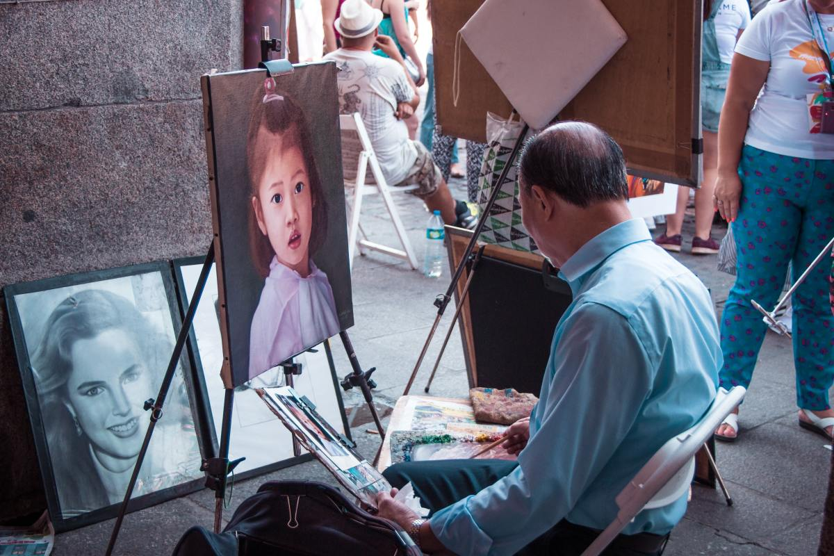 Man painting a child.