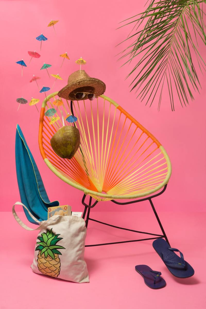 Assorted crafts of chair, bag, flip flops, and hat.