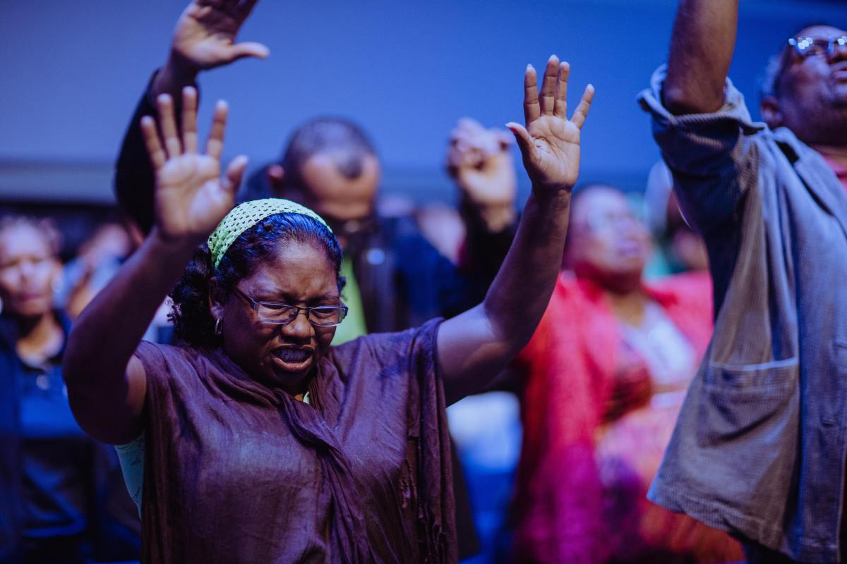 Worshippers in fervent prayer