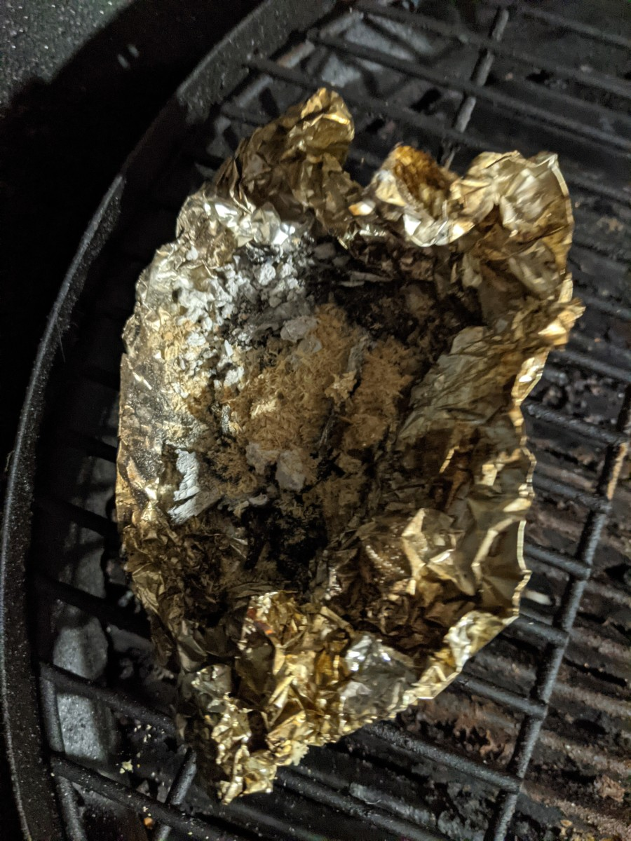 Sawdust on separate piece of foil to create smoke