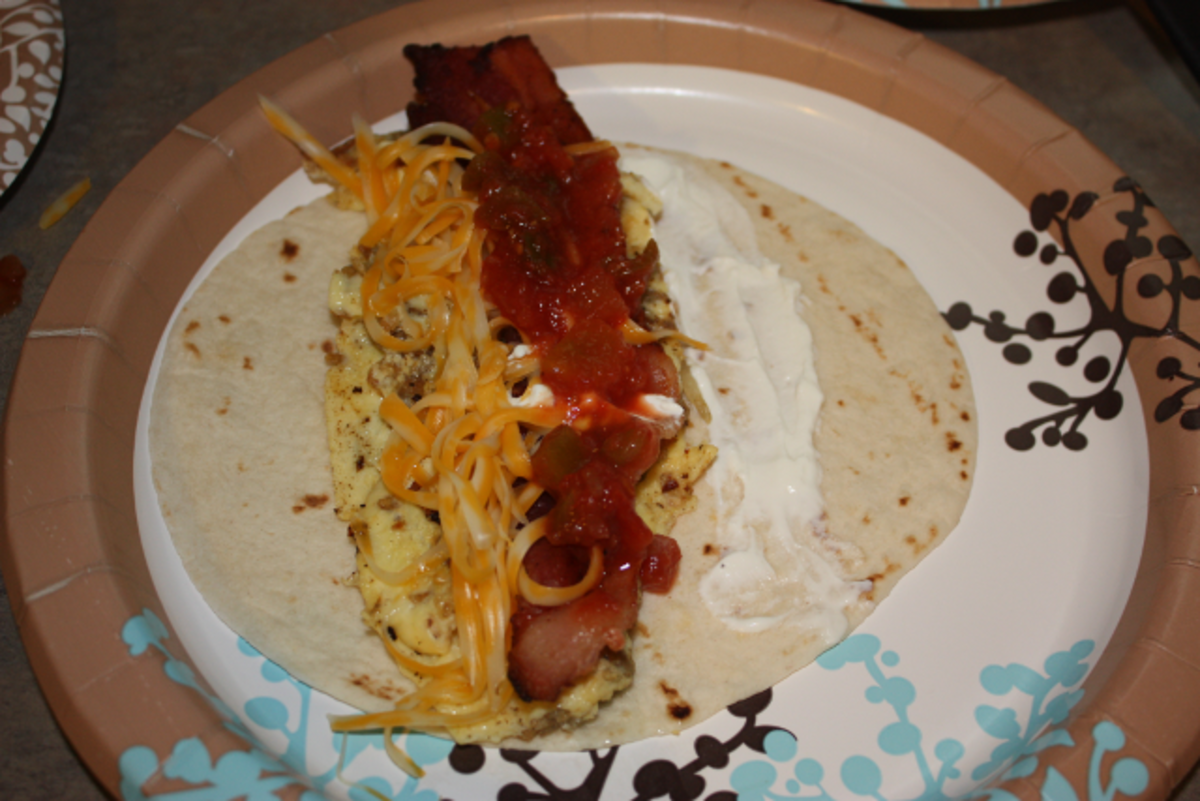Add your egg mixture, meat, cheese and sour cream to your tortilla.