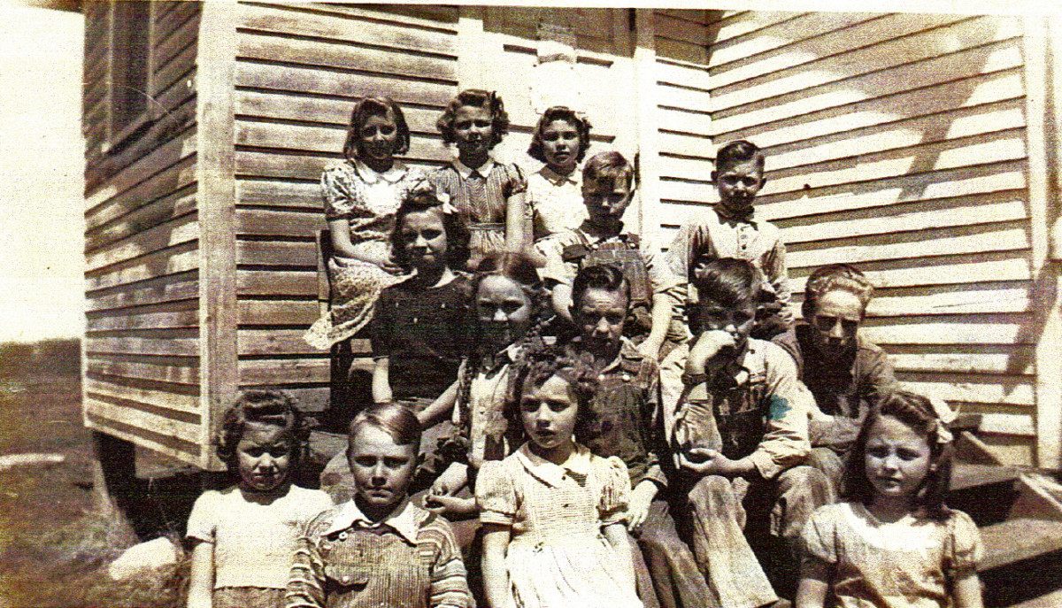 My cousin, Carolyn Stafford is in this group who attended Prairie Belle shortly before it closed down. The older boy by the steps is Howard Martin, Clyde's brother.