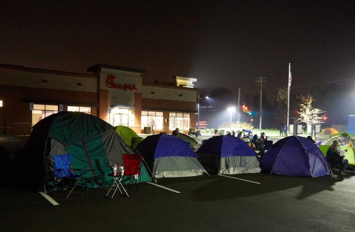 People camp out all night to be first in line at the Chick fil A