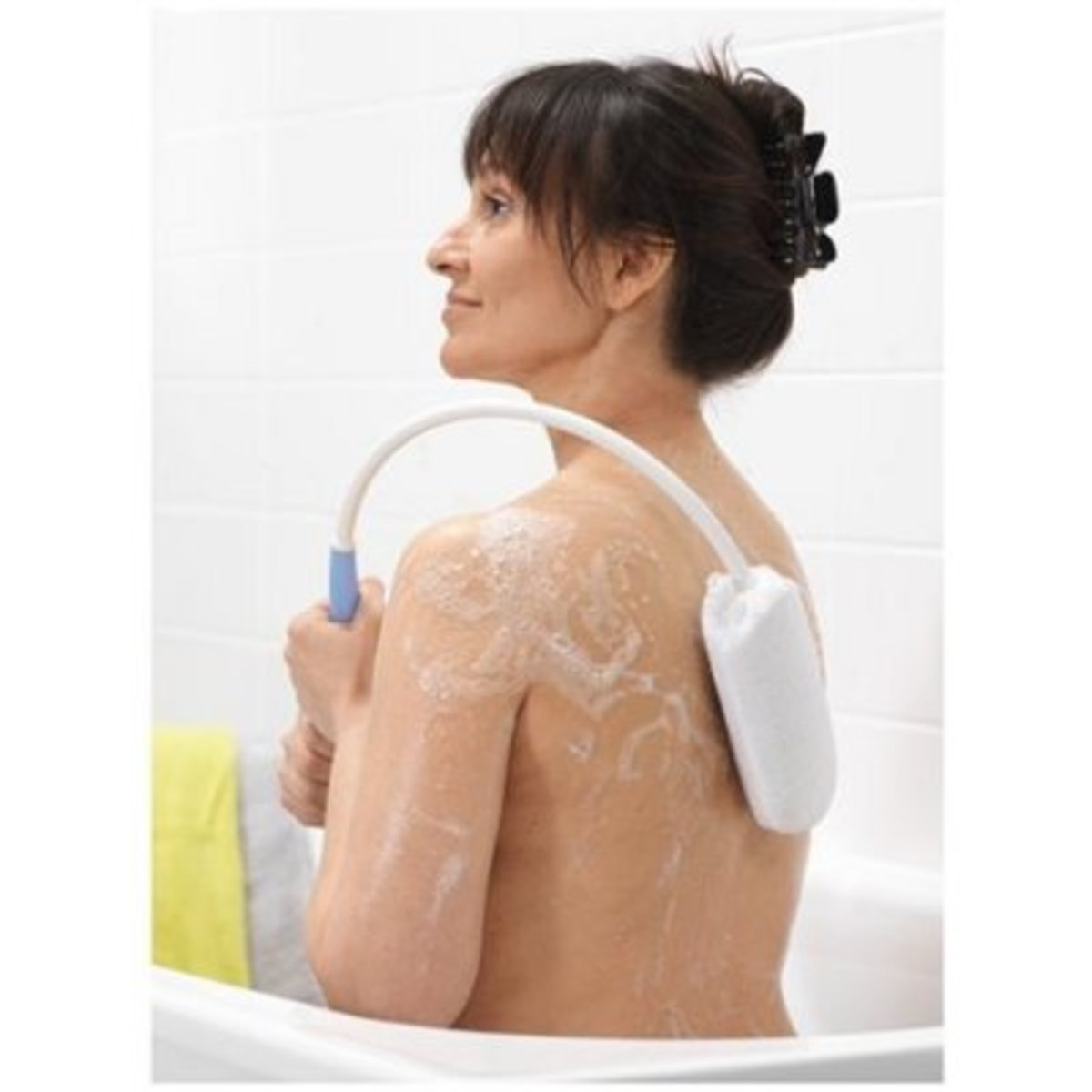 While washing with a mild soap daily is always a good idea...keeping the affected back area clean on a consistent basis will help to remove dirt and oil from pores where the grime is often collected.