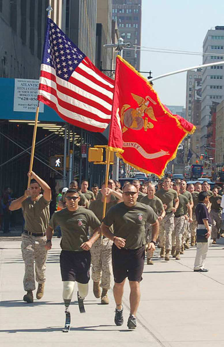 Gunnery Sgt. Angel Barcenas (with Sgt. Justin G. Brown) leads Marines, firemen, and policemen across Manhattan in 2010. His legs were amputated after injuries in Iraq in 2009.