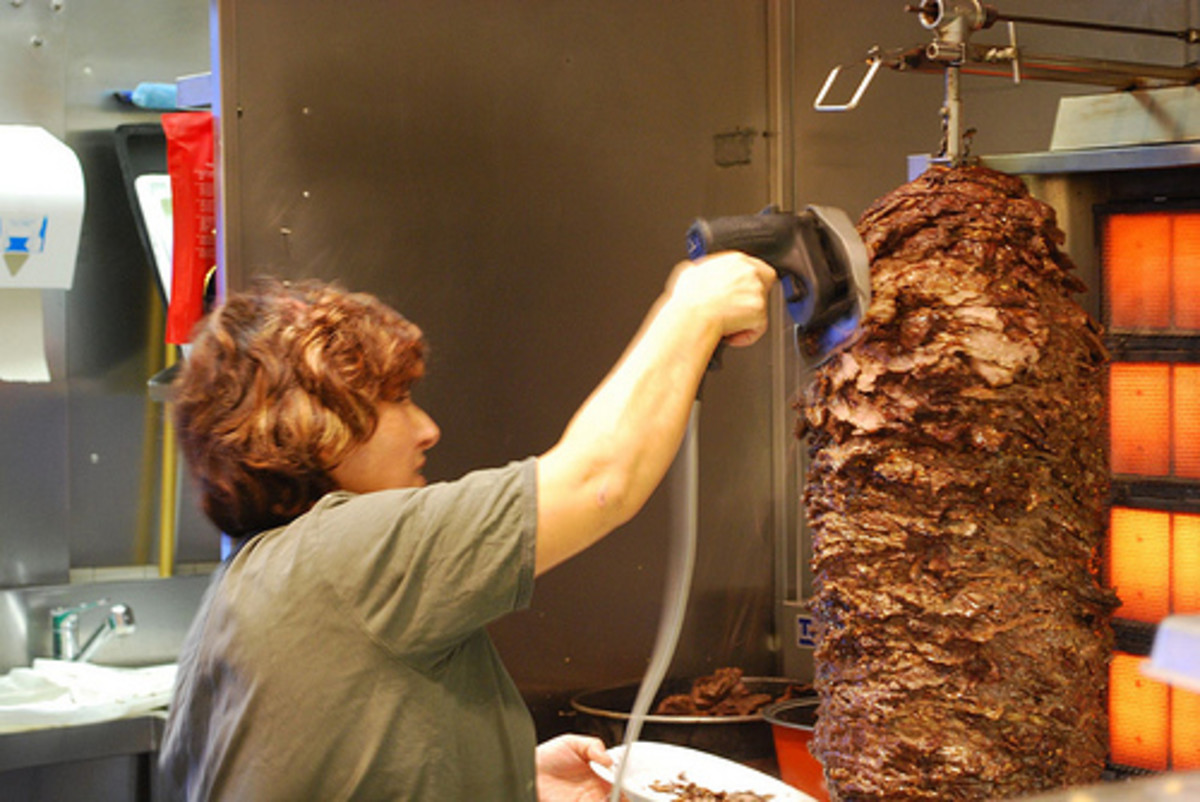 Many people save gyros for eating out because the big slabs of meat look intimidating to cook home. You can make a smaller version, though, or better-- a gyroburger!
