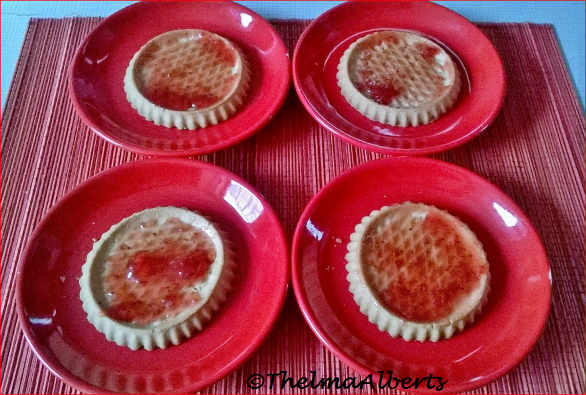 Pre-baked tartlets with marmalade spread.