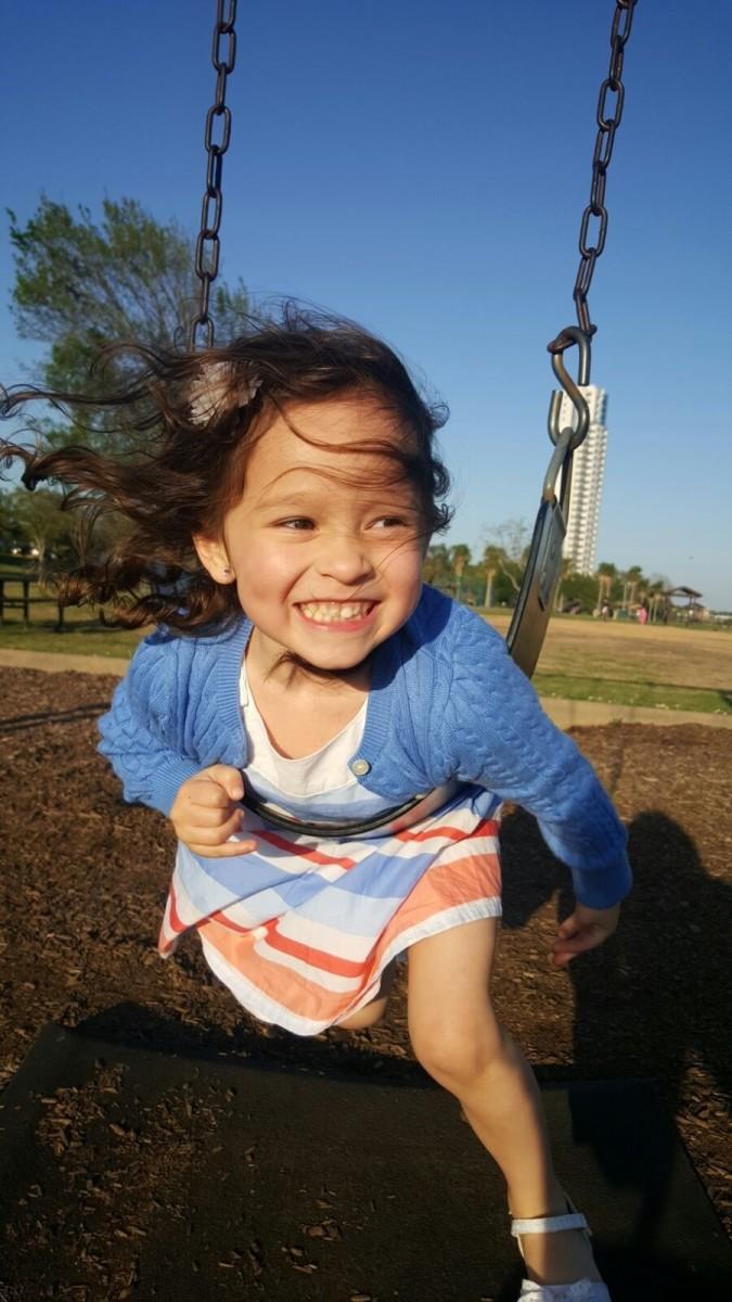 Big Smile while Swinging