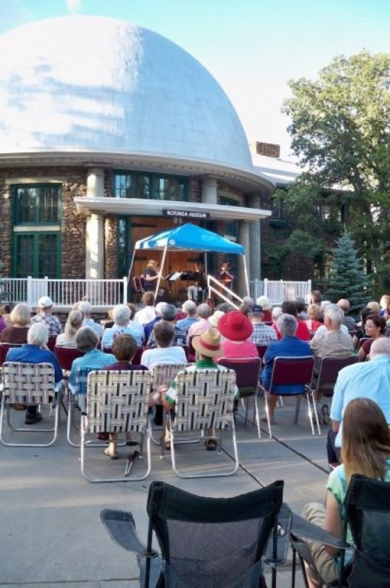 Visitors enjoy a free concert by members of the Flagstaff Symphony outside the Rotunda.