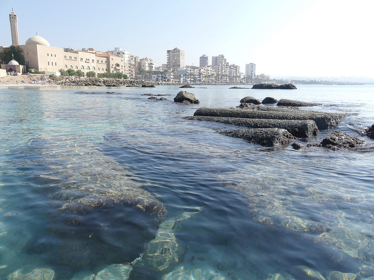 Submerged ancient columns (age unspecified) and the modern city of Tyre